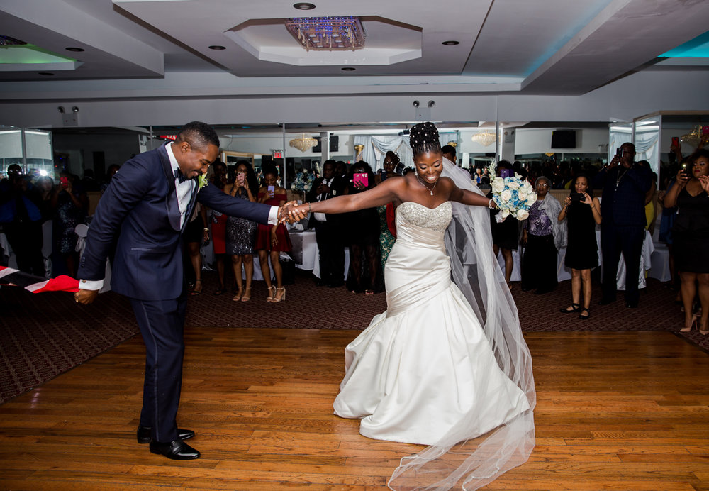 Caribbean NYC wedding couple on dance floor while guests watch