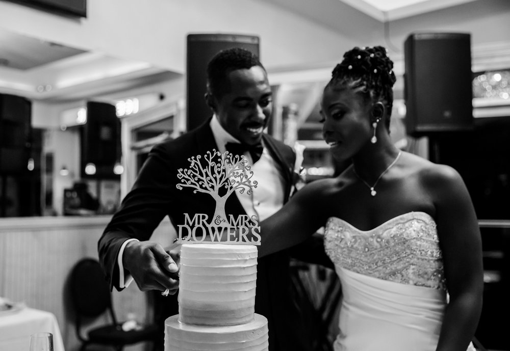 Caribbean NYC wedding cutting cake