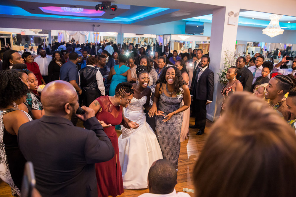 Caribbean NYC wedding sylvia laughing with guests on dance floor