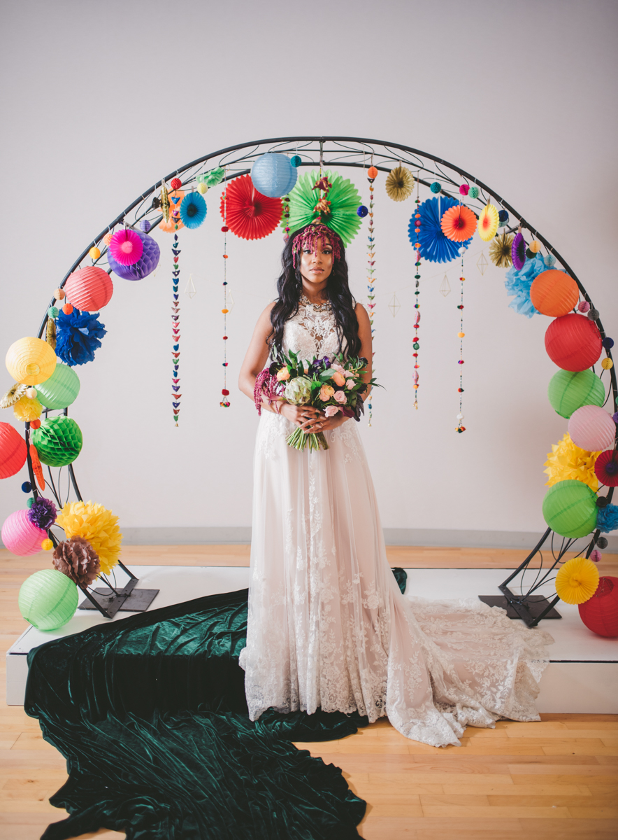 we are young worth the wait studios bride at altar with paper lantern-decorated arch