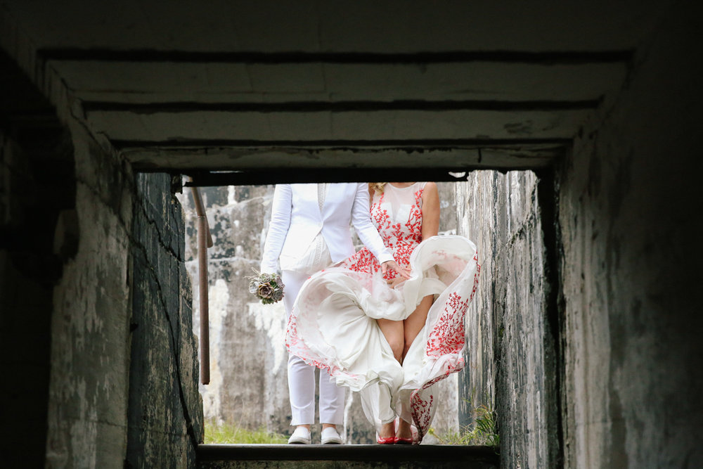 gulf shores destination wedding couple's torsos down shot from lower stairwell