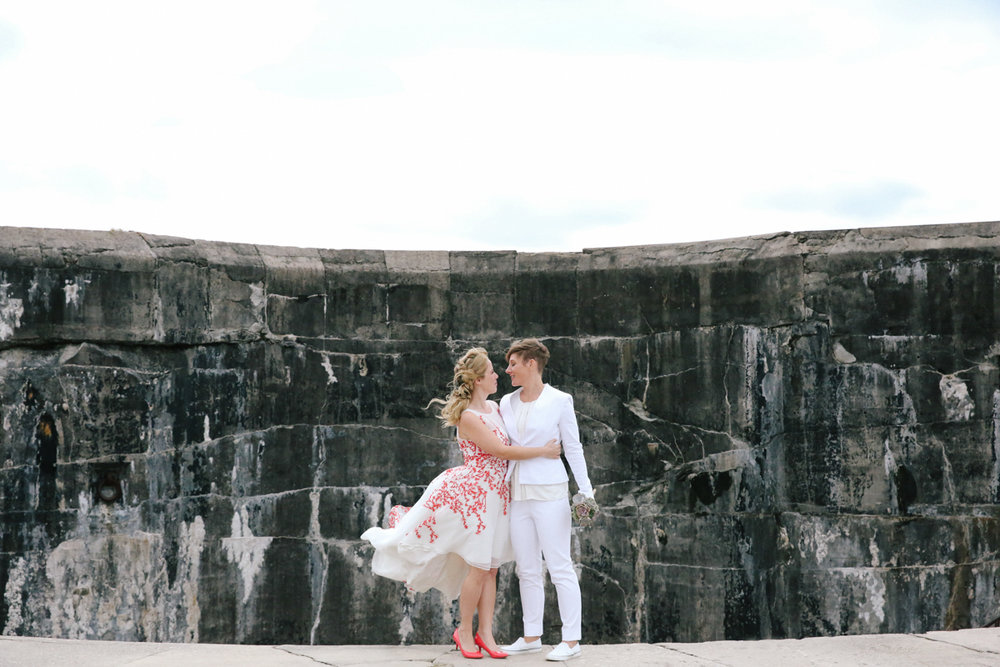 gulf shores destination wedding embrace in front of stone wall