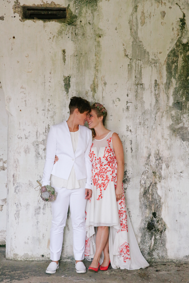 gulf shores destination wedding embrace in front of chipped wall