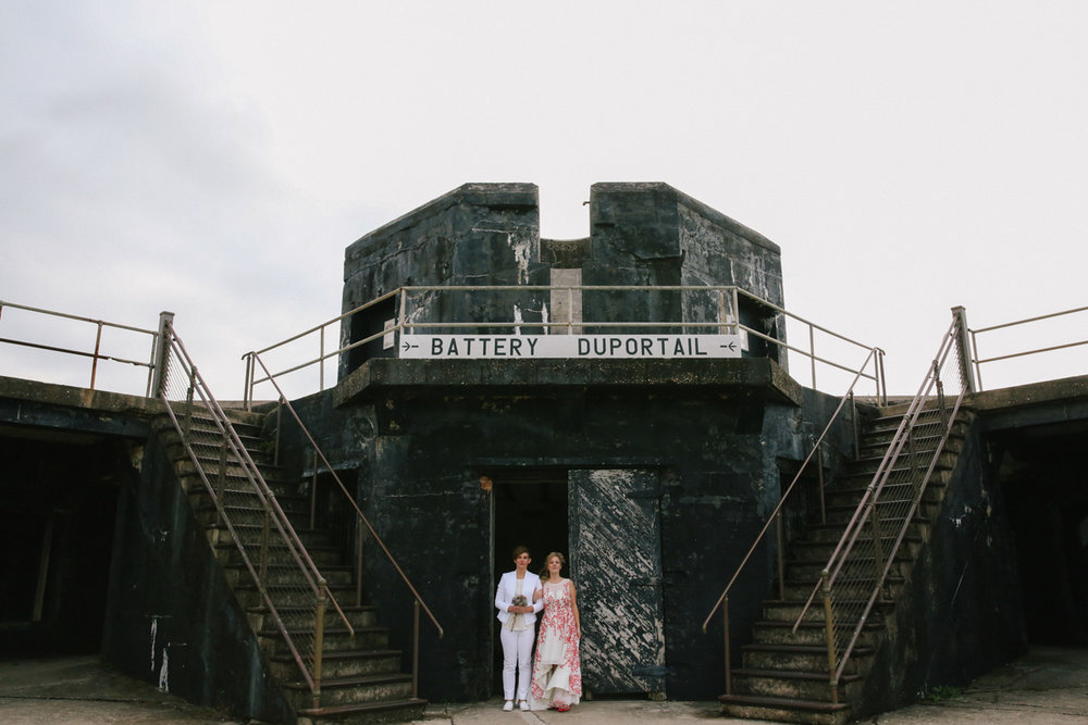 "gulf shores destination wedding couple standing under sign reading ""battery duportail"""