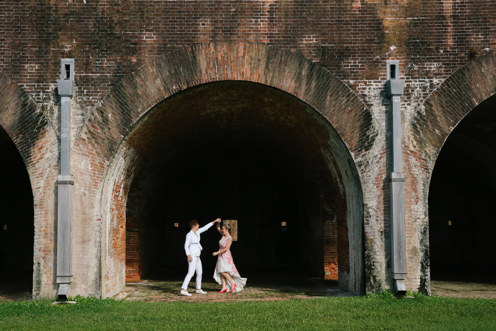 gulf shores destination wedding kate spinning ajay while under brick arch