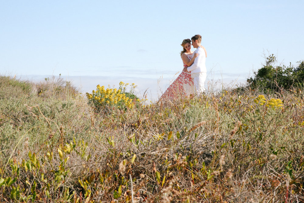 gulf shores destination wedding couple in field overlooking ocean