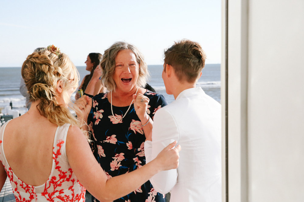 gulf shores destination wedding mom excited talking to couple