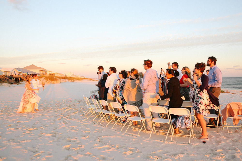 gulf shores destination wedding couple entering beach ceremony dancing