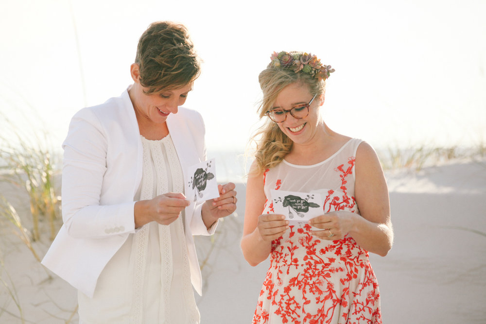 gulf shores destination wedding couple reading cards