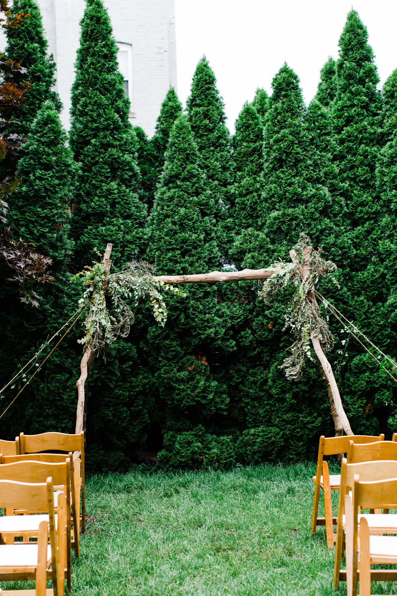 Jovial Brooklyn NY Wedding Chairs in front of Branch Altar
