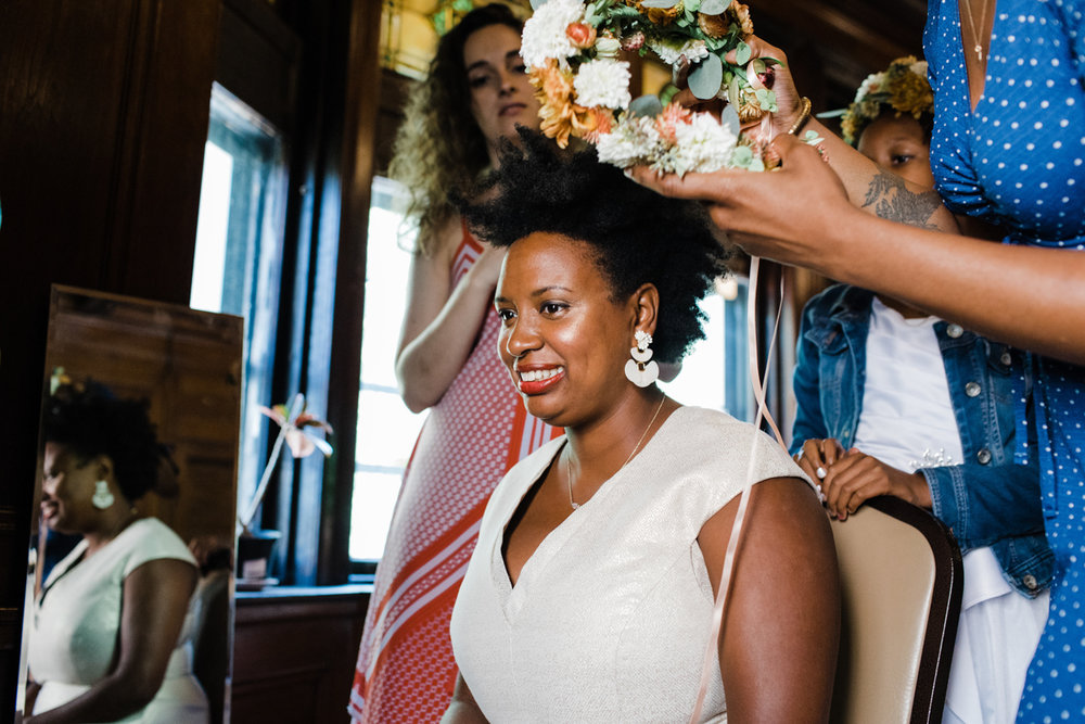 jovial brooklyn ny wedding starsha having hair done and flower crown put on