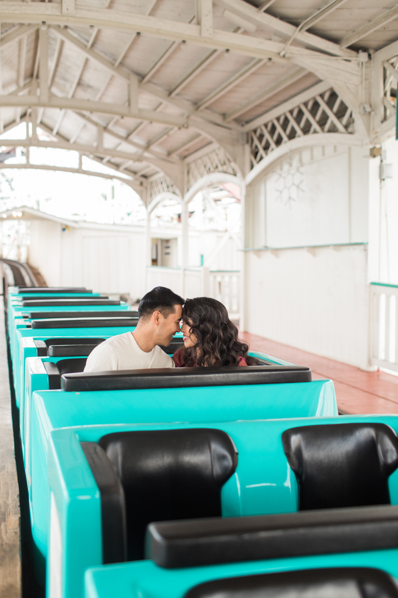 belmont park engagement session san diego angela and jamie in roller coaster seat
