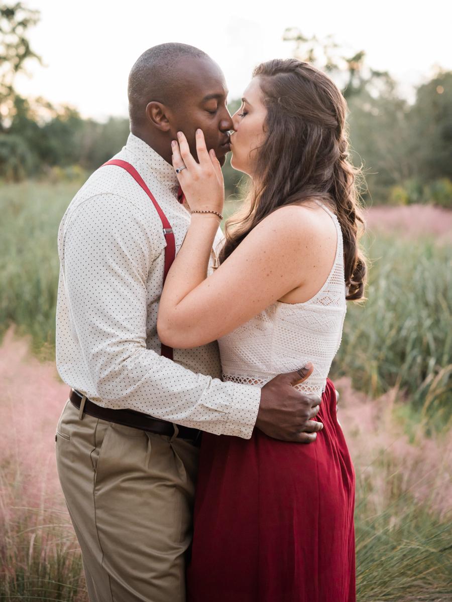 BOCA RATON ENGAGEMENT SESSION KISS IN GARDEN