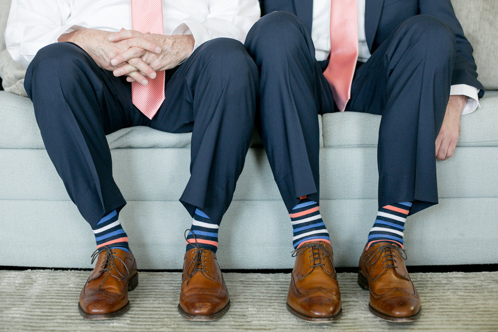 elegant, heartfelt alexandria, va wedding grooms on couch in matching outfits