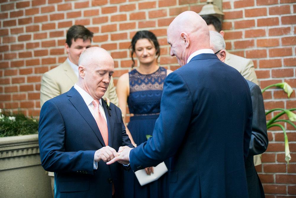elegant, heartfelt alexandria, va wedding ceremony exchanging rings