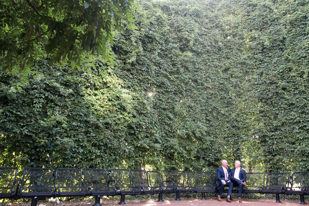 elegant, heartfelt alexandria, va wedding grooms on terrace chairs surrounded by trees
