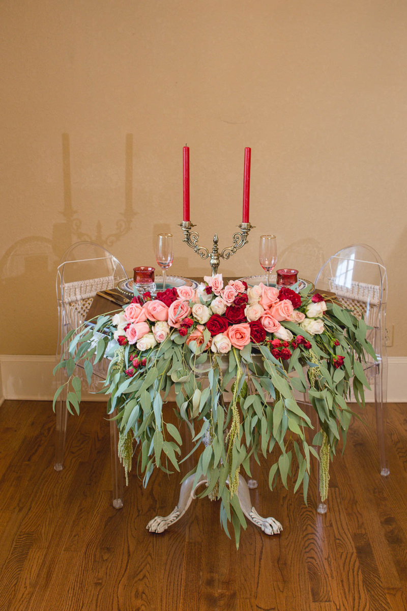 B ohemian Styled Shoot table with candelabra and rose arrangement on front