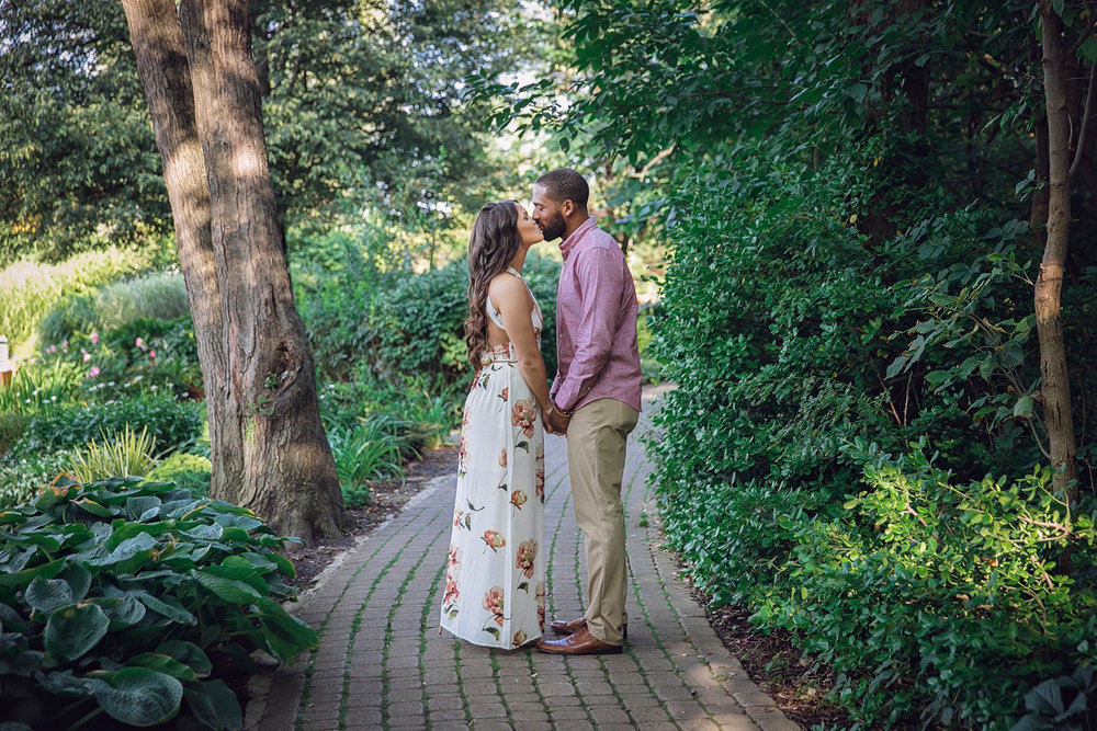 Shelby Township Michigan Garden Engagement kiss on garden path