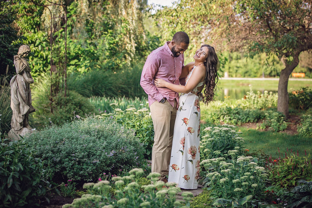 Shelby Township Michigan Garden Engagement laughing candid among flowerbeds