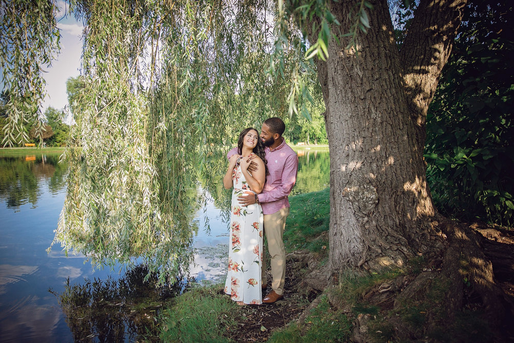 Shelby Township Michigan Garden Engagement embrace under willow tree at edge of lake