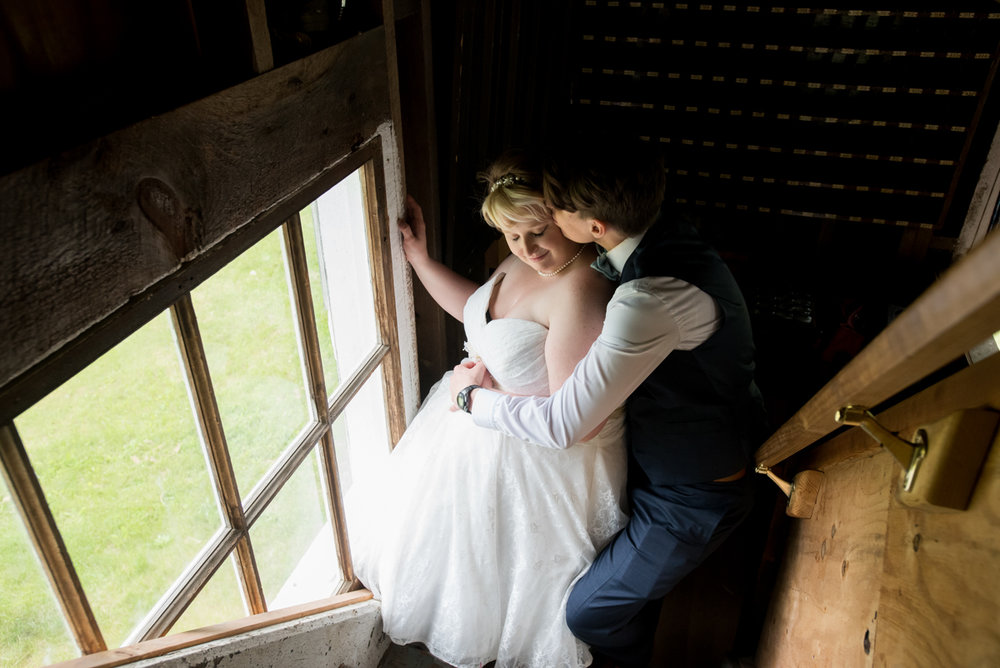 saratoga springs wedding embrace on steps near window