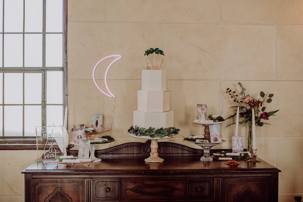 emily bauso styled shoot decorated table with cake and pictures