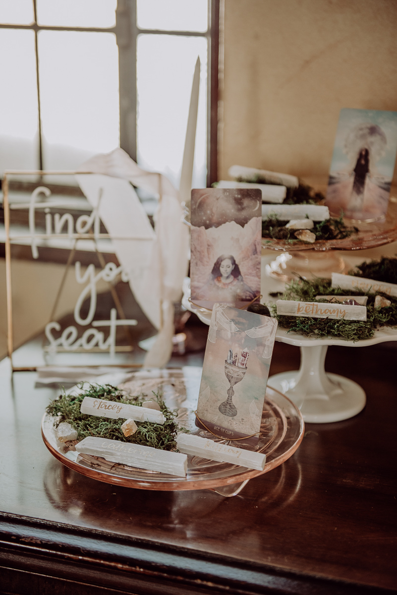 emily bauso styled shoot crystal name plates on cakestands and moss