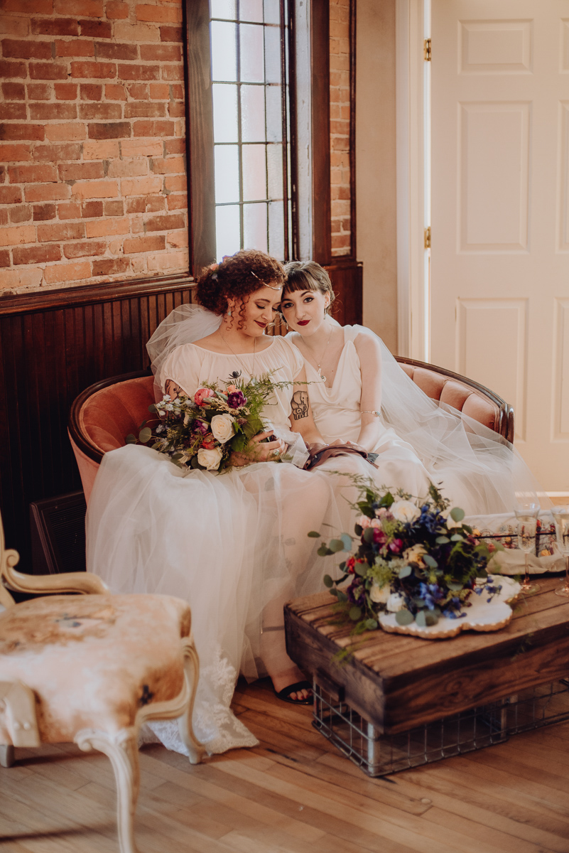 emily bauso styled shoot brides on couch