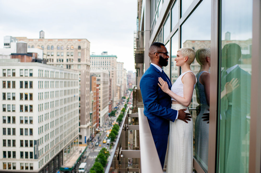 intimate new york elopement teddy and vanessa on small balcony overlooking city
