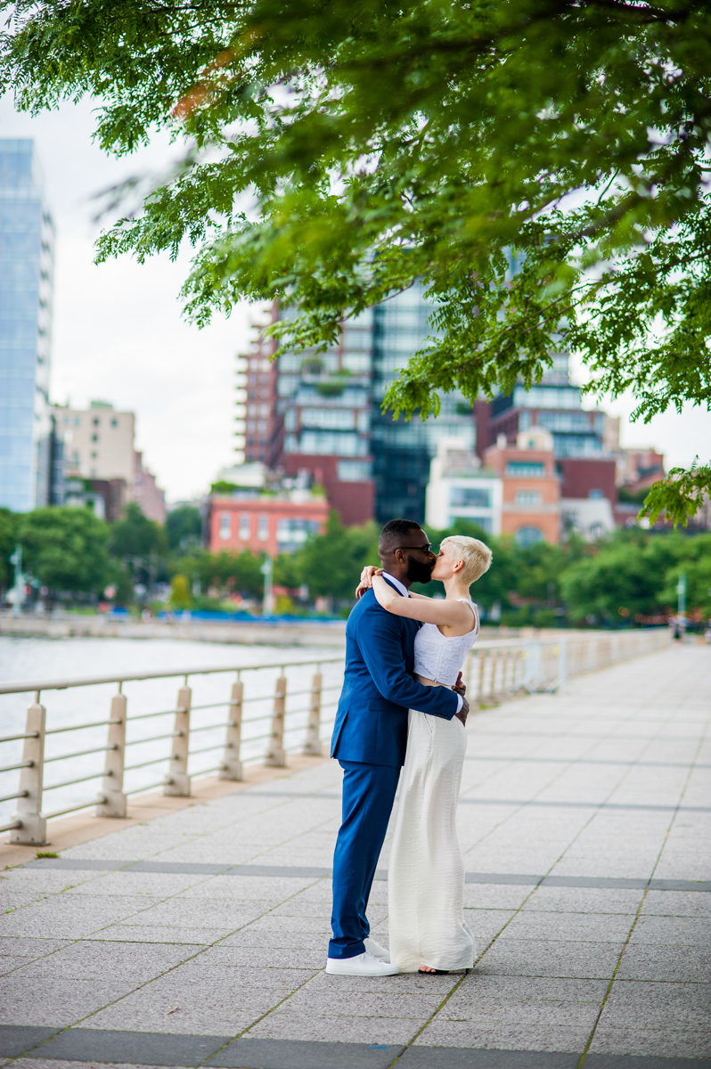 intimate new york elopement kiss by pier under tree