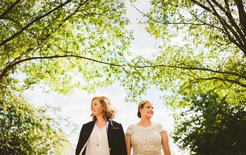 BALTIMORE WEDDING AT MOUNT WASHINGTON MILL DYE HOUSE COUPLE WALKING AMONG TREES