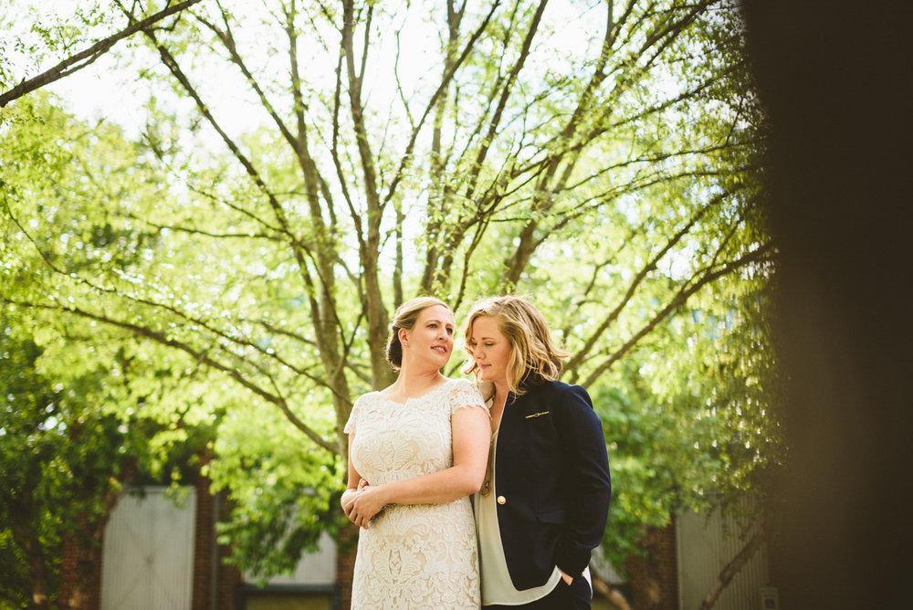 BALTIMORE WEDDING AT MOUNT WASHINGTON MILL DYE HOUSE HOPE AND MEG OUTSIDE NEAR TREE