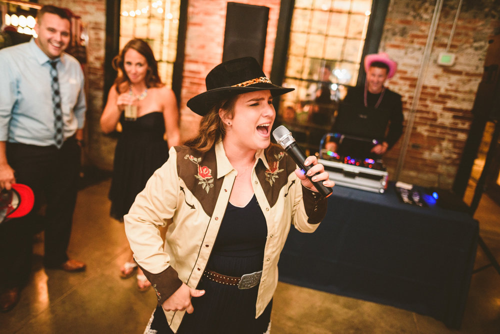 BALTIMORE WEDDING AT MOUNT WASHINGTON MILL DYE HOUSE GUEST PERFORMING SONG WHILE DJ MIKE MIXES IN BACKGROUND