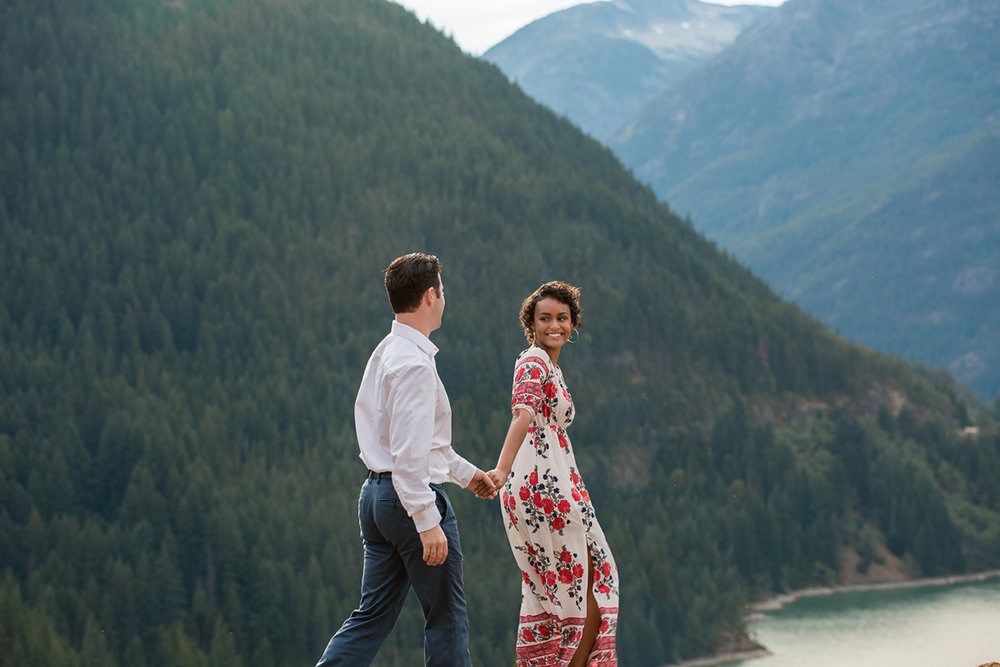 Diablo lake engagement session lyanna leading michael along by the hand
