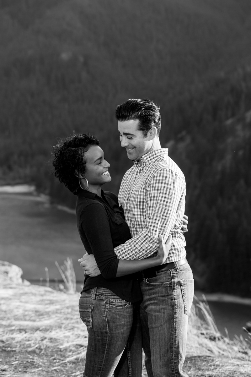 Diablo lake engagement session embrace near river