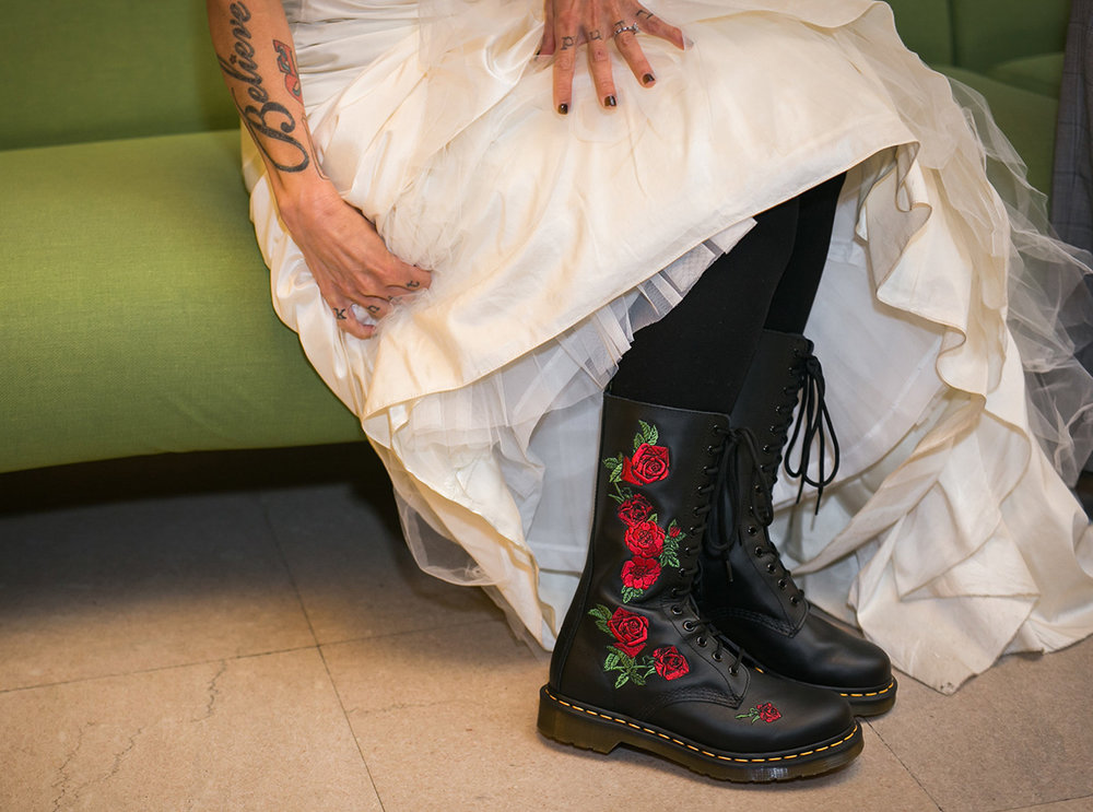 tattooed feminist elopement nyc inger's rose-embroidered combat boots under dress
