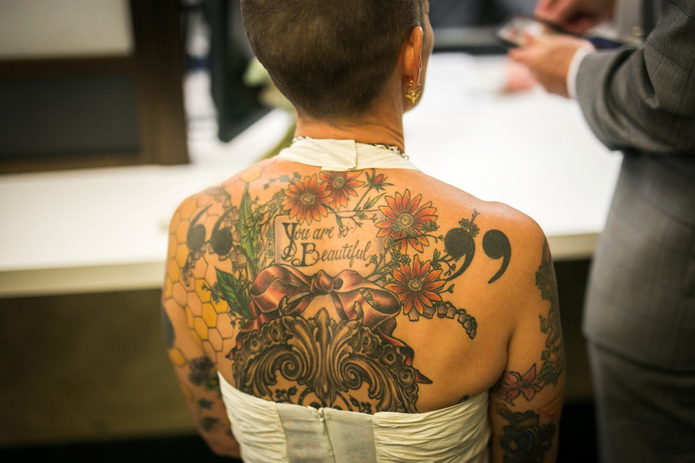 tattooed feminist elopement nyc inger's back tattoos visible in halter-neck dress