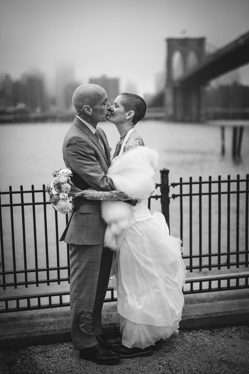 tattooed feminist elopement nyc kiss on boardwalk