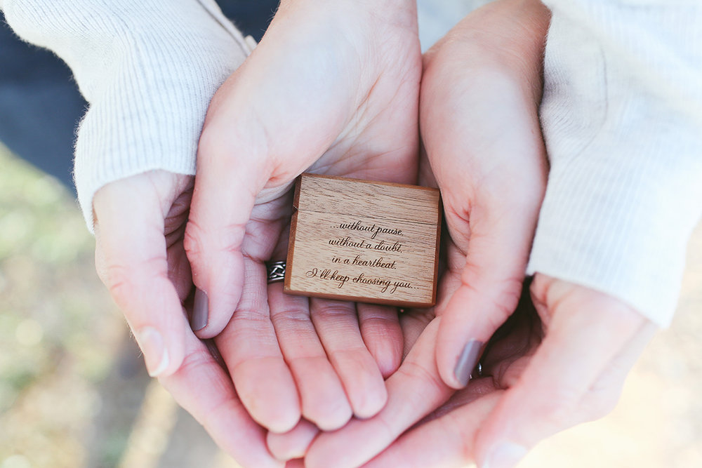 mt. airy north carolina natural engagement ashley and ruthie's hands cradling engraved ring box