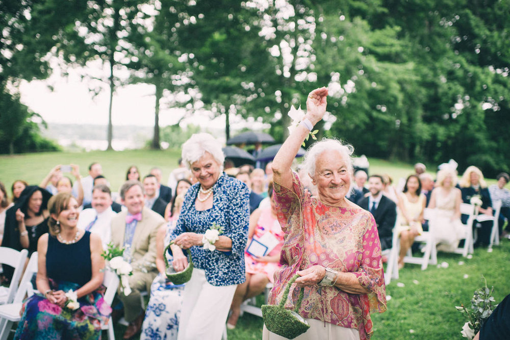 Garden wedding louisville kentucky brides' grandmothers dropping flower petals