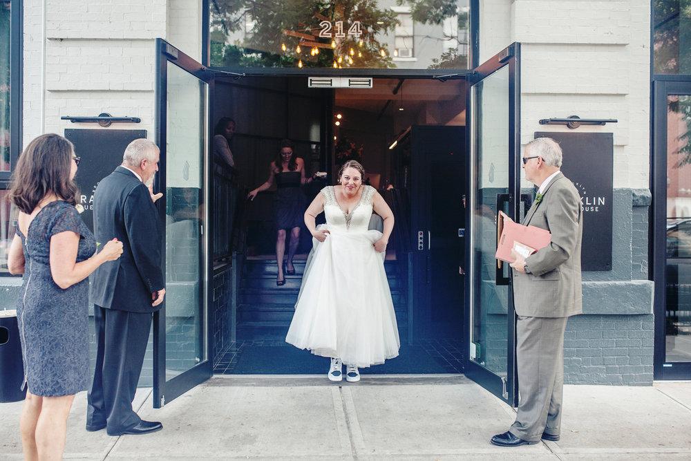brooklyn bar wedding abby and joey abby exiting hotel in wedding dress