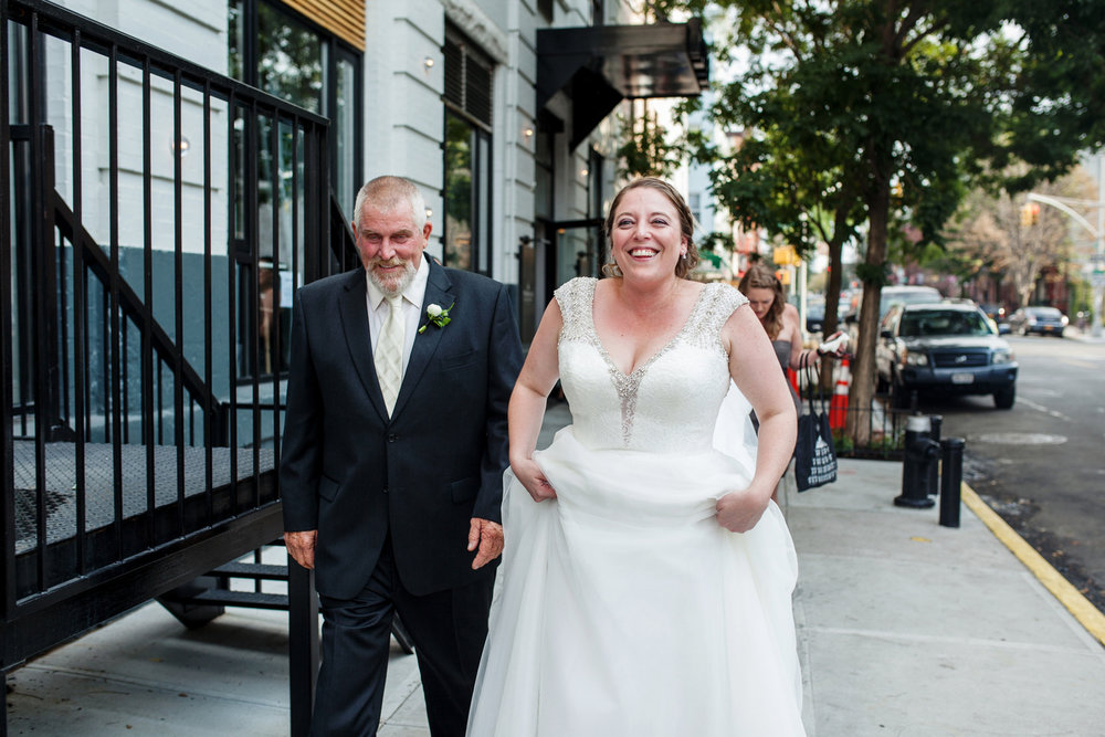 brooklyn bar wedding abby and joey abby walking down sidewalk with wedding party