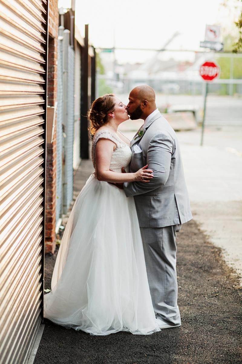 brooklyn bar wedding kiss on sidewalk