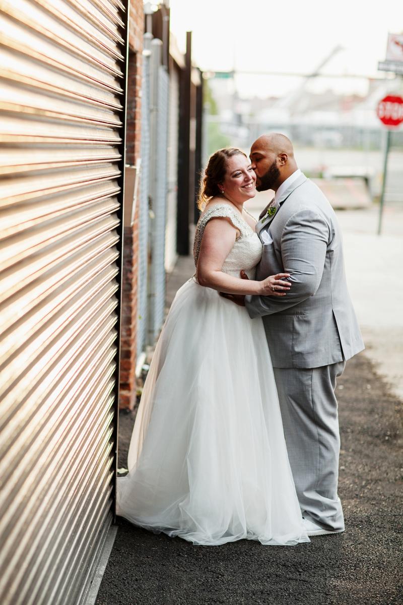brooklyn bar wedding joey kissing abby's cheek on sidewalk