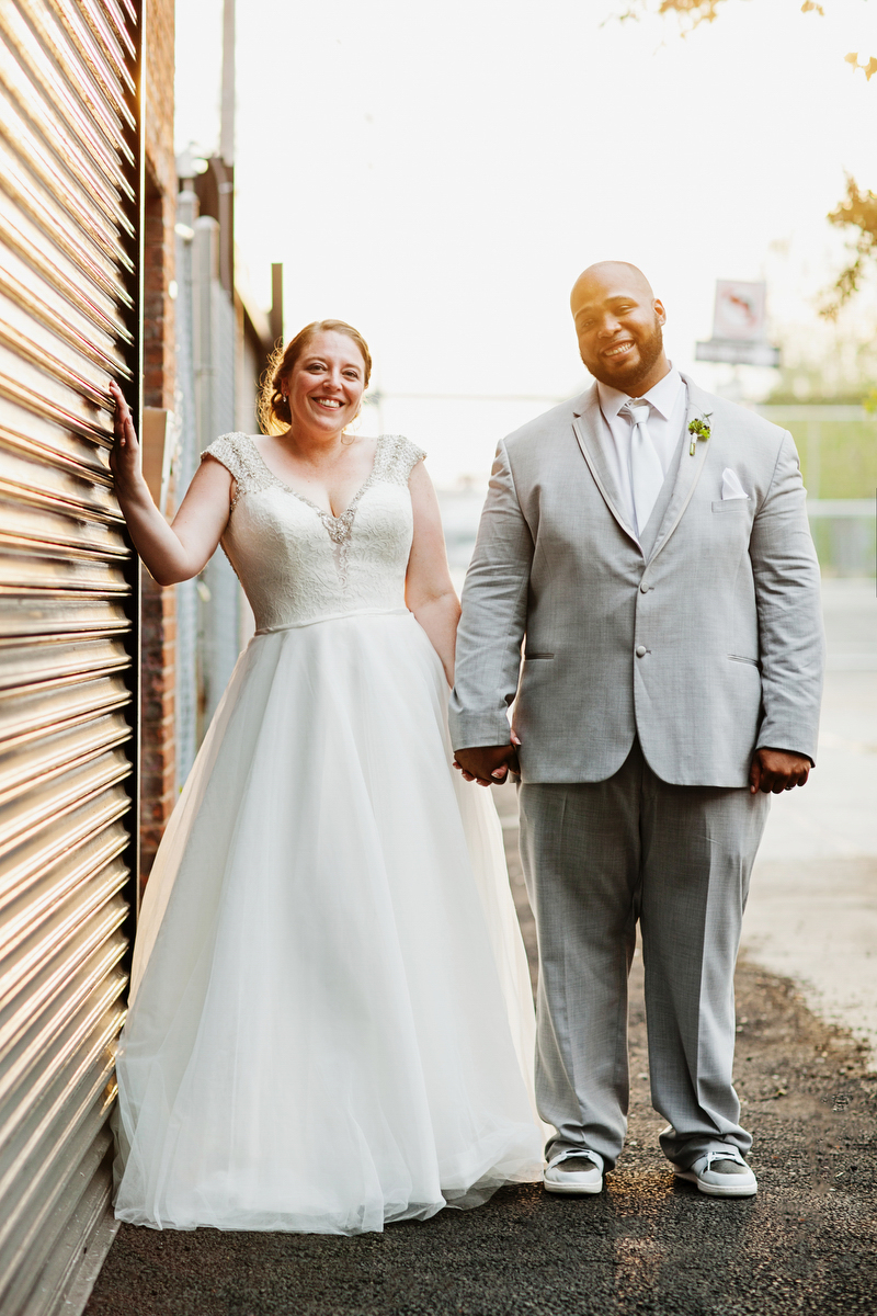 brooklyn bar wedding couple holding hands