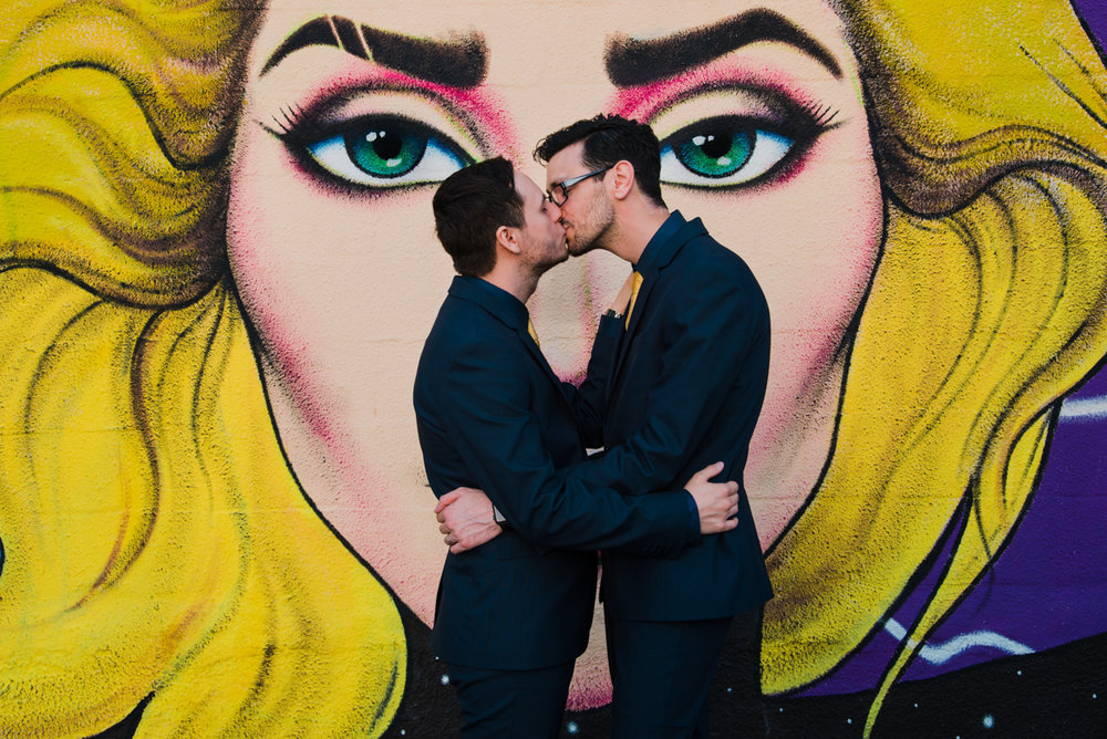 rialto theatre wedding kiss in front of large mural of blonde woman