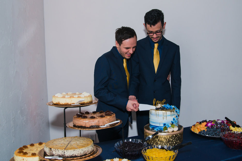 rialto theatre wedding grooms cutting main cake on dessert table