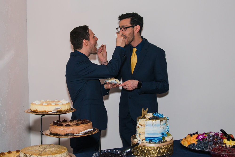 rialto theatre wedding couple feeding each other cake