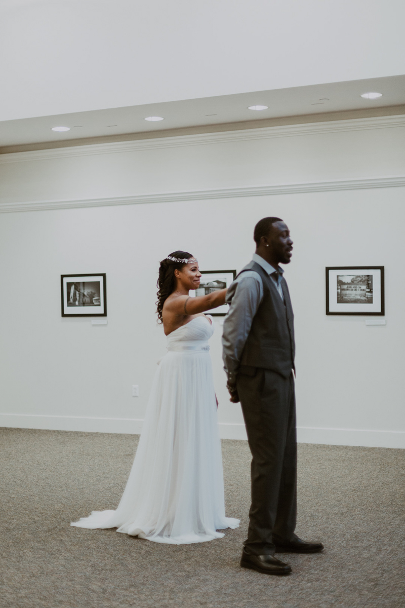 art-inspired levine museum wedding first look in portrait gallery