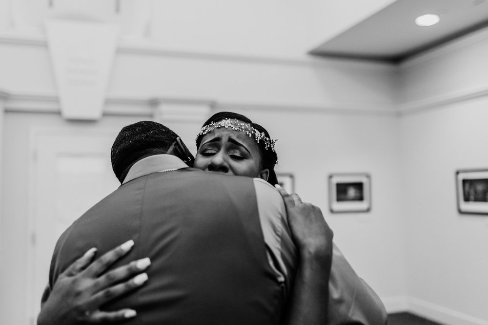art-inspired levine museum wedding first look hug